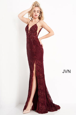 Jovani JVN00864 is an absolute stunner! Long Fitted Prom Dress or Unique Sexy Wedding Dress. Delicately Embellished Lace with a Plunging neckline & High Slit with scallop lace edges. Spaghetti straps with a slightly sheer lace bodice. JVN 00864