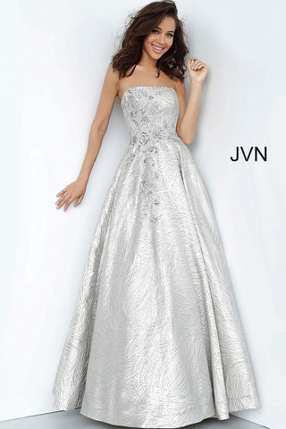JVN 02323 is a long silver strapless ballgown prom dress with a straight neckline and corset lace up back. Stunning Swirl Details sequin floral embellishments make this evening gown a true show stopper! JVN02323