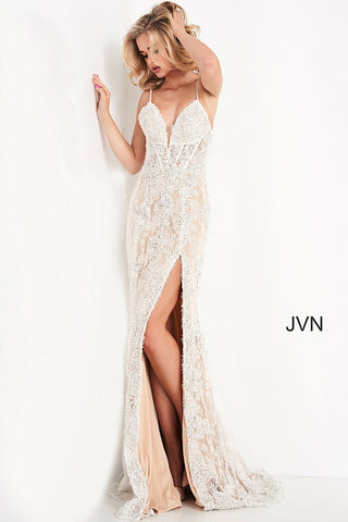 Jovani JVN05757 is a stunning eyelash lace long fitted formal evening gown. Featuring a deep V plunging Neckline with a sheer corset style bodice with boning. Sexy slit in the skirt with eyelash lace edges. Great wedding gown or reception dress. Prom, Pageant & More! JVN 05757  Available Sizes: 00,0,2,4,6,8,10,12,14,16,18,20,22,24  Available Colors: Ivory/Nude, Navy/Nude