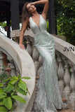 JVN 3663 is a long Form Fitting Mermaid silhouette prom dress, Pageant gown & evening formal wear. Featuring a plunging neckline with crystal embellishments along the straps, edges of bodice & waist belt. Open back with crystal embellished straps. Full mermaid flare skirt.