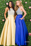 JVN49432 Crystal embellished fitted bodice, sleeveless, high neckline, close back, full mikado skirt with pockets.
