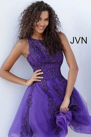 JVN63907 Purple beaded short homecoming dress with high neckline, sleeveless fitted bodice and sheer closed back, short length flared and pleated skirt featuring multiple layers. Short cocktail dress homecoming dress.