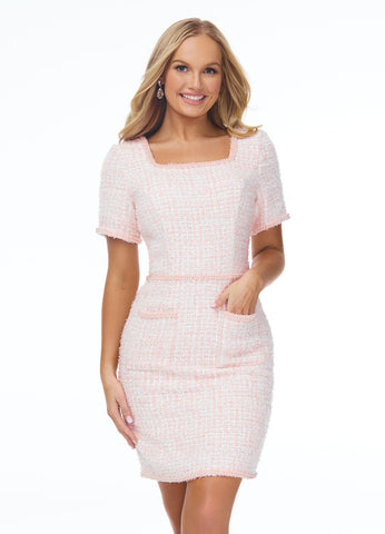 Ashley Lauren 4432 This tweed cocktail dress with pearl trim is perfect for your next event. The square neckline, short sleeves, pockets and hem are trimmed with pearl details. The look is brought together with a pearl belt.  Color Blush  Sizes 0, 2, 4, 6, 8, 10, 12, 14, 16, 18  Tweed Square Neckline Pearl Trim Sleeves