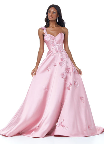 Ashley Lauren 11002 Dazzle in this prom dress ball gown with floral applique. The one shoulder strap and sweetheart bustier evening gown are adorned with floral applique that trickles down the skirt. The skirt is complete with pockets.  Colors Blush, Royal, Deep Red  Sizes  0, 2, 4, 6, 8, 10, 12, 14, 16  One Shoulder Sweetheart Neckline Floral Applique A-Line Skirt