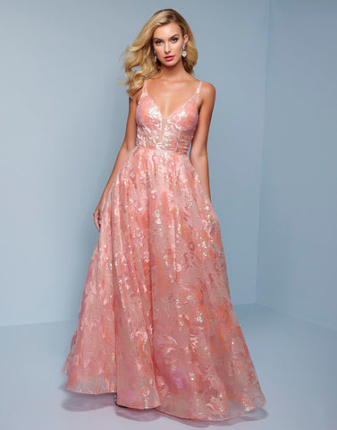 Splash Prom K513 Made in a lovely shade of peach, this long prom dress is absolutely fabulous. The a line silhouette of this evening gown is made of sparkling sequin fabric.  The v neckline bodice has a sheer illusion panel and is covered in sparkling sequins appliques. Thin spaghetti straps finish this style off. Color Peach  Sizes 0-14