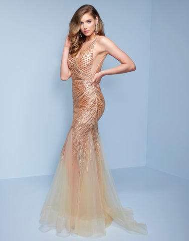 Splash Prom k514 This is a sheer gold sequin embellished prom dress with rows and rows of gold shade beading.   The wrap style effect of this evening gown flatters all figures and has a v neckline and scoop low open back. Sheer nude tulle flare above the knew showcases a short dress underneath it. Color Gold  Sizes 00-28
