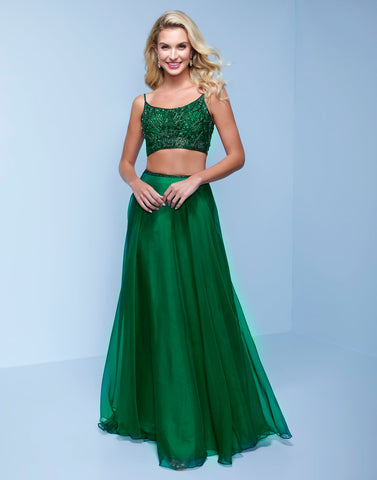 Splash Prom K574 This is a long two piece sky chiffon prom dress.  This formal evening gown has an embellished crop top with a scoop neckline and spaghetti straps that lace up and tie in the open back.  The flowy floor length skirt has a matching embellished waistline. Color  Emerald  Sizes  00, 0, 2, 4, 6, 8, 10, 12, 14, 16, 18, 20, 22, 24, 26, 28