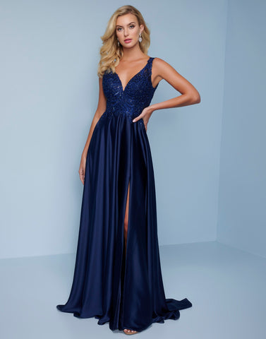Splash Prom K576 This is a Navy long evening gown with a v neckline and cutout in the back.  The bodice is embellished lace with a smooth crepe floor length skirt with a slit.  Color  Navy  Sizes  00, 0, 2, 4, 6, 8, 10, 12, 14, 16, 18, 20, 22, 24, 26, 28