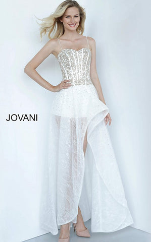 Jovani Kids k66709 is a Girls Party Dress, Kids Pageant Gown & Pre Teen Formal Evening Wear gown. This Stunning Girls Dress Features a sweetheart neckline with spaghetti straps and a fitted Corset style bodice with boning. Detailed Embellishments & Crystals along the top. Sheer Lace Accented with scattered AB Crystals defines this High Low Silhouette with shorts underneath. Pageant Romper Girls.   Available Girls Sizes: 8, 10, 12, 14  Available Colors: Off White