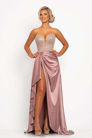Johnathan Kayne 2235 This exquisite prom dress has an extraordinary embellished bodice that wraps around to the open corset lace up tie back. This pageant gown has a charmeuse skirt with gathers and a high side slit. Colors  Mauve, Black  Sizes  00, 0, 2, 4, 6, 8, 10, 12, 14, 16