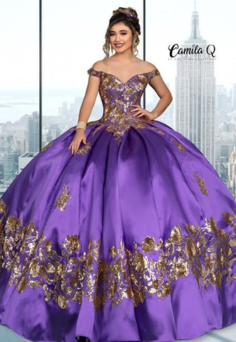 Camila q Quinceanera Q1116 off the shoulder mikado ball gown with lace up corset back and sequin applique details throughout this long formal gown. Perfect for your next Quince or Sweet 16.  Colors  Purple/Gold  Sizes  00, 0, 2, 4, 6, 8, 10, 12, 14, 16, 18, 20, 22, 24, 26, 28, 30