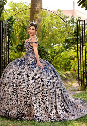 Camila Q Quinceanera Q1120 off the shoulder with double straps that cross over the shoulders and down to the lace up corset back.  This ball gown is mega glittered and over the top for your next Quince, Sweet 16, Prom or next special event. Colors  Navy/Gold, Red/Gold  Sizes  00, 0, 2, 4, 6, 8, 10, 12, 14, 16, 18, 20, 22, 24, 26, 28, 30