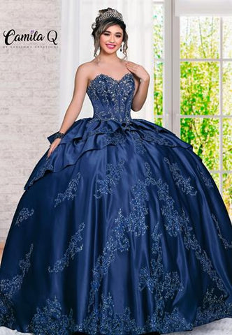 Camila Q Qinceanera Q1121 strapless sweetheart neckline lace up corset bodice and full skirt with layers of embroidered satin. Perfect for your next sweet 16, Quince or special event. Colors  Champagne/Gold, Navy/Silver  Sizes  00, 0, 2, 4, 6, 8, 10, 12, 14, 16, 18, 20, 22, 24, 26, 28, 30