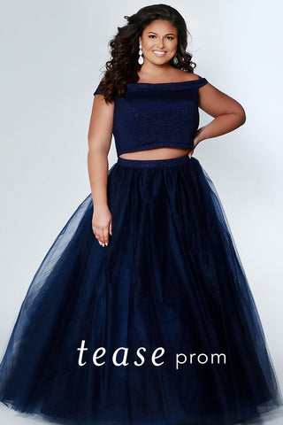 TE1909  Be a trend setter at Prom wearing a monochrome two-piece plus size dress. Sparkly red or blue off-shoulder top and tulle skirt with curly horsehair hem. Crop-top and waistband in matching light-red sparkle-embedded fabric. This dress is right on trend for prom.