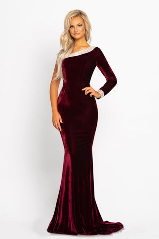 Johnathan Kayne 2046 is a one shoulder long sleeve velvet Prom dress, Pageant Gown & Formal Evening wear. This Gorgeous Stretch Velvet Dress Features a One Shoulder Long Sleeve. The Asymmetrical neckline as well as the edges of the sleeve and back are Rows of Detailed Crystals. Fit & Flare Silhouette leads to a beautiful sweeping train.