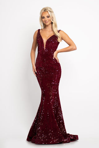 Johnathan Kayne 2237 This long prom dress has a plunging v neckline with mesh panel and a mid v back and is made of luxurious stretch velvet scattered with sequins.  The long mermaid skirt on this pageant gown has a sweeping train. Colors  Crimson, Emerald  Sizes  00, 0, 2, 4, 6, 8, 10, 12, 14, 16, 18, 20, 22