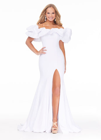 Ashley Lauren 11017 Wow in this off shoulder scuba evening gown. The off shoulder neckline is adorned with an oversized ruffle that perfectly frames your face. The fitted skirt is complete with a slit.   Excellent Prom and Pageant Gown.   Colors:  Hot Pink, Red, White, Navy  Sizes   0, 2, 4, 6, 8, 10, 12, 14, 16  Off Shoulder Oversized Ruffles Fitted Slit Scuba