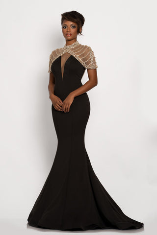 Johnathan Kayne 2283 This is a long fitted mermaid prom dress with a sheer embellished short cape.  This evening pageant gown has a long sweeping train. Colors Black, Hot Coral  Sizes  00, 0, 2, 4, 6, 8, 10, 12, 14, 16