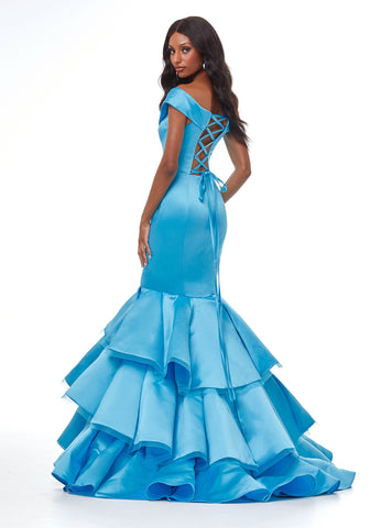 Ashley Lauren 11053 All eyes will be on you in our this satin mermaid pageant gown. The wrap off the shoulder details of this prom dress gives way to a fitted skirt complete with tiered mermaid ruffles. The lace up back is sure to provide you with an exceptional fit.  Colors Ivory, Turquoise, Fuchsia  Sizes   0, 2, 4, 6, 8, 10, 12, 14, 16,  Lace Up Back Off Shoulder Mermaid Silhouette Satin