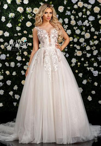 Adagio Bridal W9320 is a long Beaded Applique Tulle Ballgown wedding dress with a sheer lace neckline with a plunging bodice with sheer mesh inserts. Open back.  Stunning and Lush. Tulle Ballgown with a sheer illusion high neckline and detailed floral appliques. lush sweeping train. Perfect Bridal Gown for a Romantic Princess appeal.
