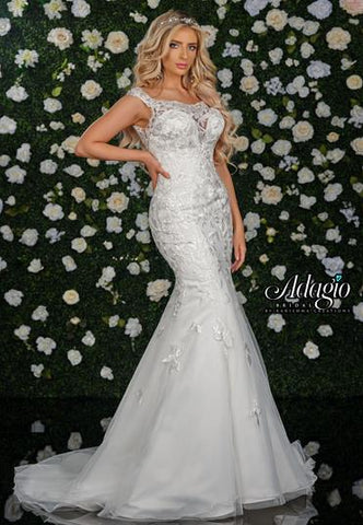 Adagio Bridal W9341 off the shoulder lace mermaid wedding gown bridal dress with sheer lace scoop neckline and sheer back with lace and bridal buttons down the back.