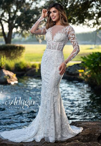 Adagio Bridal W9364 long sleeve fitted sheer corset style beaded lace wedding dress bridal gown with sheer neckline and sheer lace sleeves.  The back is sheer lace with bridal buttons down the back Color  Ivory, White   Sizes  00, 0, 2, 4, 6, 8, 10, 12, 14, 16, 18, 20, 22, 24, 26, 28, 30