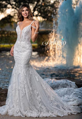 Adagio Bridal W9365 plunging v neckline mermaid embellished lace wedding dress bridal gown with train features double straps one off the shoulder to create cold shoulder effect.  Colors  Ivory  Sizes  00, 0, 2, 4, 6, 8, 10, 12, 14, 16, 18, 20, 22, 24, 26, 28, 30