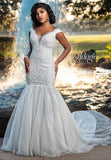 Adagio Bridal W9378 off the shoulder with plunging neckline and sheer panel mermaid wedding dress evening gown with long tulle train Color Ivory  Sizes  00, 0, 2, 4, 6, 8, 10, 12, 14, 16, 18, 20, 22, 24, 26, 28, 30