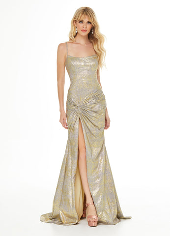 Ashley Lauren 11008 This spaghetti strap metallic jersey prom dress is sure to steal the show. The lace up back helps ensure you get the perfect fit. The hip is accentuated with a twist knot detail that gives way to a right leg slit.  Colors Jade, Fuchsia, Gold  Sizes 0, 2, 4, 6, 8, 10, 12, 14, 16, 18  Spaghetti Straps Metallic Jersey Twist Knot Detail Lace Up Back Slit