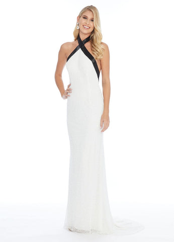 Ashley Lauren 1924 Dazzle in this elegant evening gown featuring a criss-cross black liquid beaded neckline giving way to a beaded skirt. The low back adds a sexy flair.  Fully Beaded Halter Neckline Fitted Silhouette Low Back Available colors: Ivory/Black  Available sizes:  0-16
