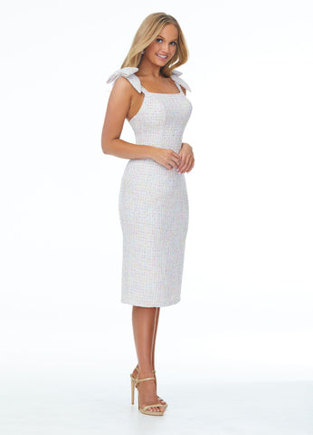 Ashley Lauren 4433 Perfect for your next event, this tweed mid-length cocktail dress features a scoop neckline with straps. The straps are embellished with the most adorable bows!   Color Ivory  Sizes 0, 2, 4, 6, 8, 10, 12  Tweed Bow Details Mid-Length Fit & Flare