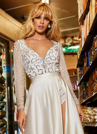 Ashley Lauren 4422 Stunning intricately beaded bodysuit featuring a V-Neckline and long sleeves. Complete the look with an ASHLEYlauren satin or organza overskirt. Fully Beaded V-Neckline Long Sleeves Bodysuit Skirt Pictured is style 1997