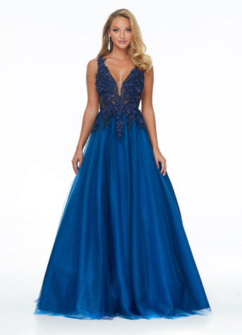 Ashley Lauren 1995 Stunning V Neckline illusion bodice prom dress featuring 3-Dimensional flowers and beading. The illusion bodice on this evening gown gives way a full tulle ballgown skirt.  Color Navy  Sizes  0, 2, 4, 6, 8, 10, 12, 14, 16  Illusion Bodice 3-Dimensional Flowers Tulle Skirt A-Line V-Neck