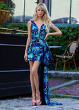 Ashley Lauren 11005 Make an entrance in this V-Neckline cocktail dress with oversized bow detail. The fitted cocktail dress skirt is adorned with an oversized bow that drapes all the way down to the floor.  Color Multi/Royal  Sizes 0, 2, 4, 6, 8, 10, 12  V-Neckline Oversized Bow Sequin