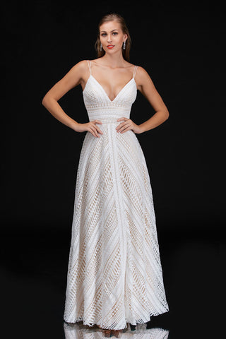 Nina Canacci 4199 is a long bohemian lace v neckline formal dress with spaghetti straps. A Line silhouette with asymmetrical lace pattern and wide waist band. Great Boho Choice for a simple destination or vintage Design.  Available Sizes: 0, 2, 4, 6, 8, 10, 12, 14   Available Colors: Ivory/Nude