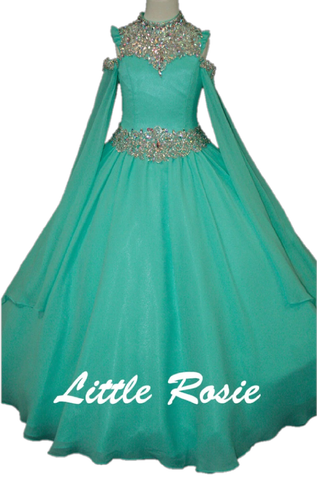Little Rosie LR2702 - 2702 by Bali Bali Fashion - features an incredible embellished beaded neckline with thousands of sparkling crystals and rhinestones. This winner girls pageant dress gives you the option of wearing without the sheer long sleeves since its detachable. With this stunning pageant dress you get two beautiful look each time you wear this dress. A full blown chiffon skirt in floor length skirt comes with an attached crinoline for added volume. A Line Ballgown. Crystal Rhinestone embellished H