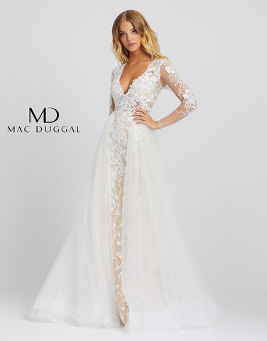 Mac Duggal 26322M - 26322 Love this dress so much you'll want to re-wear it for your wedding! Style 26322M is an ivory nude ball gown with sheer long sleeves, a v-neckline, and overskirt. This incredible gown has embroidery detailing from head to toe. This Mac Duggal Prom Collection 26322M ivory nude formal gown has a fitted silhouette in embroidered tulle, with a deep V-neckline and illusion long sleeves. The illusion bodice is offset with a fully lined skirt, finished with a gathered overskirt that cascad