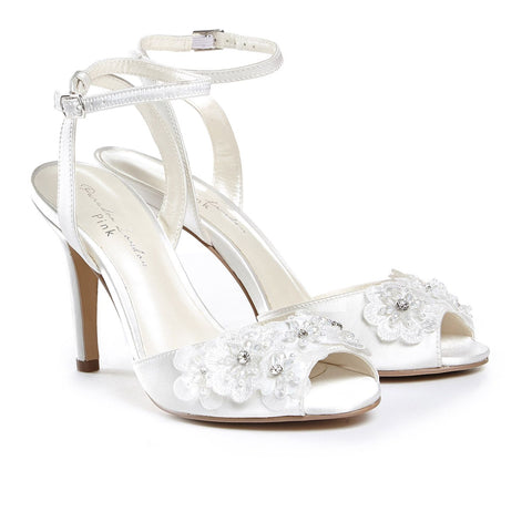 Paradox London Pink MOONFLOWER Benjamin Walk Moonflower is a stunning sandal made out of ivory satin material with pearls/stones on the vamp featuring a 3.5 inch heel and manmade sole. Great Formal Bridal Peep Toe Shoe. Available Sizes: 5, 6, 6.5, 7, 7.5, 8, 8.5, 9, 9.5, 10  COMPANY: Paradox London BRAND: Paradox London Pink COLOR: Ivory MATERIAL: Satin 3D Floral Appliques