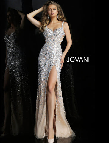 Jovani 59846 Nude/Silver beaded high slit prom dress  Available Size: 00-24  Available Color: Silver/Nude  Nude and silver fully embellished long prom dress with sweetheart neckline, shoulder straps, open back with beaded straps and side cut-out, floor length fitted skirt with high side slit and sheer nude end.