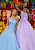 Ashley Lauren 11004 Show off your romantic side in this one shoulder tulle prom dress ball gown with sequin applique. The bustier is adorned with floral sequin applique that trickles down the A-Line skirt of this evening gown.   Colors Sky, Lilac, Ivory, Black/Nude  Sizes 0, 2, 4, 6, 8, 10, 12, 14, 16, 18, 20, 22, 24  One Shoulder A-Line Sequin Applique Tulle