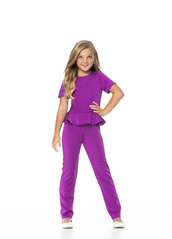 Ashley Lauren 8063 This girls and preteen's crepe jumpsuit is perfect for your next pageant or event. It has a crew neckline, short sleeves, peplum waist and straight leg pants.  Colors Purple, Orange, Red, Royal   Sizes  2, 4, 6, 8, 10, 12, 14, 16   Crew Neckline Short Sleeves Peplum Waist Details Tonal Belt Straight Pants