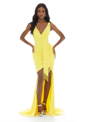 Ashley Lauren 11051 Dare to stand out in this V-Neck jersey evening gown featuring ruching and a high-low skirt. The look is accented by a faux tie waist detail trimmed in fringe! Great Prom, Pageant, Cocktail, Fun Fashion Evening Dress.   Colors  Hot Pink, Yellow  Sizes   0, 2, 4, 6, 8, 10, 12, 14, 16  V-Neckline Fitted Jersey High-low Fringe Accents