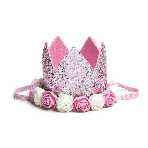 Sweet Wink - The Pink Flower Crown is the perfect addition to any birthday party or everyday dress up! Since this crown does not have a number on it, it can be worn for multiple occasions. Makes a great birthday present for any little girl in your life! Item description:  Pink glitter crown Pink and ivory flowers trim the base of the crown Light pink felt lining inside the crown and on the bottom of the crown to ensure comfort and softness on the child's head Light pink elastic to secure crown to child's he