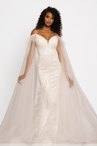 Johnathan Kayne 2173 is a long mermaid silhouette prom dress, pageant dress & Formal Gown with a detachable Feather Embellished tulle Cape. Stunning V neckline with spaghetti straps. Beading & Embellishments adorn the bodice & waist on this gorgeous evening gown.