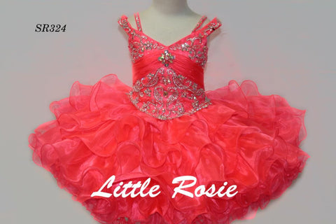Little Rosie SR324 is a short girls cupcake pageant dress. Featuring a fitted crystal rhinestone embellished bodice with illusion off the shoulder straps. gathered waist line with crystal accent. short ruffled layer skirt. Available Size: 4  Available Color: Flamingo