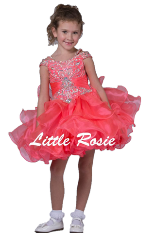 Little Rosie SR330 is a gorgeous Girls Cupcake Pageant Dess. Featuring double off the shoulder straps fully crystal embellished as well as an embellished fitted bodice with a gathered chiffon waistline. Lush layered ruffle cupcake skirt. Available Size: 6  Available Color: Coral
