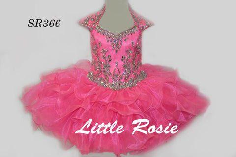 Little Rosie SR366 is a Gorgeous Girls Cupcake short Pageant Dress. Featuring a Crystal Rhinestone embellished fitted bodice with a collar v neck and cap sleeves. cut out back. Lush Ruffle layered cupcake skirt.  Available Size: 6   Available Colors: Hot Pink