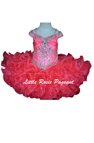Little Rosie SR403 is a short Ruffle Girls Cupcake Pageant Dress. Featuring a fitted crystal rhinestone embellished bodice with double illusion off the shoulder straps. Lush Short ruffle skirt. Available Size: 5  Available Color: Flamingo