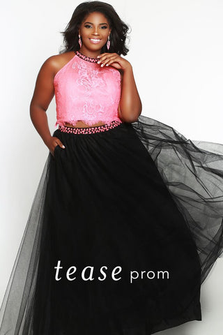 TE1717  Charm the crowd in this trendy best-selling two-piece halter prom dress. Sparkle with matching beading on the neckline and high-waistband. Keyhole back with zipper adds sexy detail. Eye-catching color combinations to suit every Prom personality.