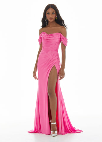 Ashley Lauren 11019 The off shoulder straps of this evening gowns bustier and back are adorned with ruching that is placed perfectly to accentuate your curves. The back is complete with a cut out. The skirt is finished with a slit. Perfect for evening, Prom or Pageant.   Colors  Ocean, Pink, Lilac  Sizes   0, 2, 4, 6, 8, 10, 12, 14, 16  Off Shoulder Low Back Slit Chiffon